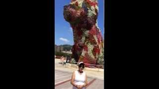 Aruna Sharma around Flower Puppy near Guggenheim Museum, Bilbao Spain July 23, 2014