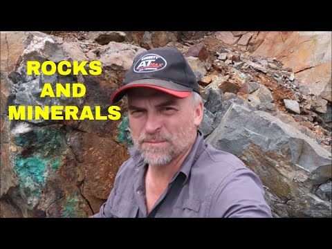 Investigating Rock Specimens In An Abandoned Gold And Silver Mine