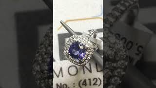 ESTATE TIFFANY & CO TANZANITE & DIAMOND HALO RING
