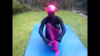 Zentai girl is back with pink fishnet body-stockings doing some jum...
