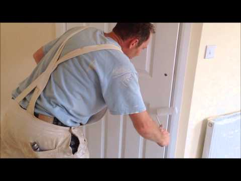 How to paint a new door in a finish coat of paint with a roller
