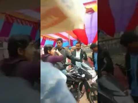 A girl giving tight slap to a men