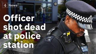 Police officer shot dead in London police station