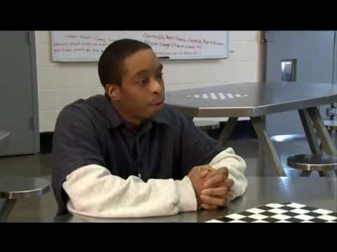 Dr. Robert Avossa talks with Fulton County Jail inmates