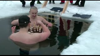 Russian ice swimmers play chess in frozen lake
