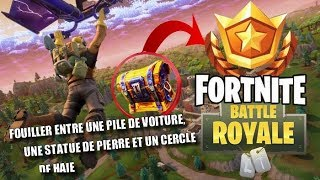 SEARCH BETWEEN A PILE OF CARS, A STONE STATUE, AND A CIRCLE OF HEDGES - FORTNITE