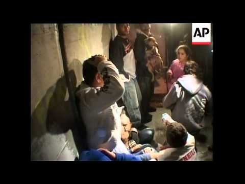 WRAP 3 Palestinians killed by Israeli airstrike; people in shelter as rocket hits