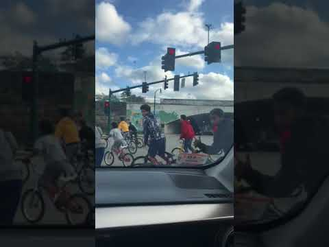 Group of Roughly 3 Dozen Kids on Bikes in Downtown Worcester