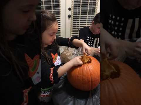 Cleaning the pumpkin guts out so we can carve a pumpkin