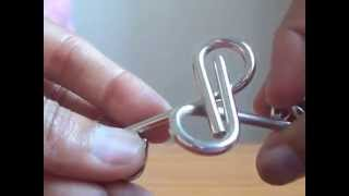 Solution to P shaped Metal ring puzzle