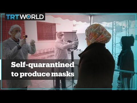 Tunisian workers self-quarantine in factory to manufacture masks