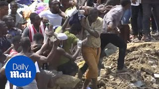 Young boy pulled alive from building rubble in Lagos, Nigeria