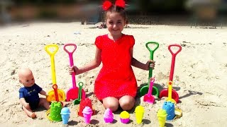 Kid and Doll play with toys on the beach