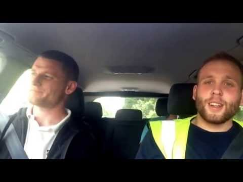 4 workers singing in the car