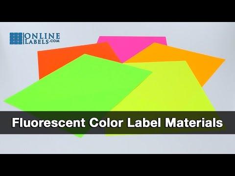Fluorescent color labels spread out across a table.