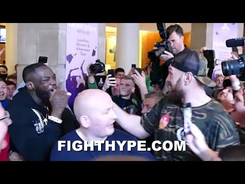 (WOW!) DEONTAY WILDER & TYSON FURY ERUPT AND GO AT IT; SEPARATED DURING SHOUTING MATCH