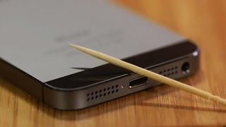 Http://cnet.co/1u7y4dp the lightning port on your ios device can become clogged over time. cnet's dan graziano shows you how to clean it out.