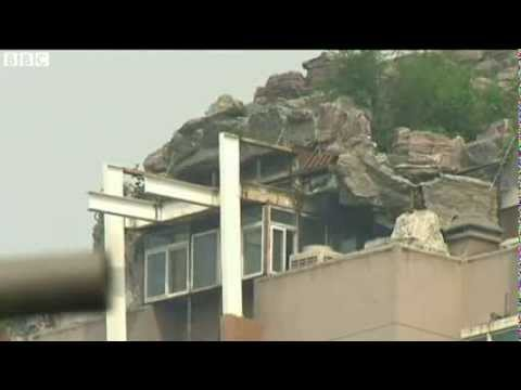 BBC News   Beijing rock villa on high rise roof may be demolished