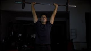 Young Indian sportsman lifting a heavy barbell in gym - Fitness Regime