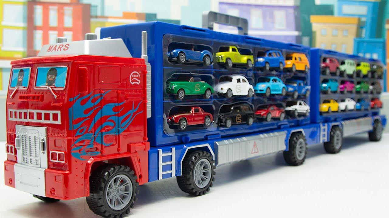 장난감 카캐리어에 들어있는 미니자동차를 꺼내보아요 Take out the mini car in the toy car carrier