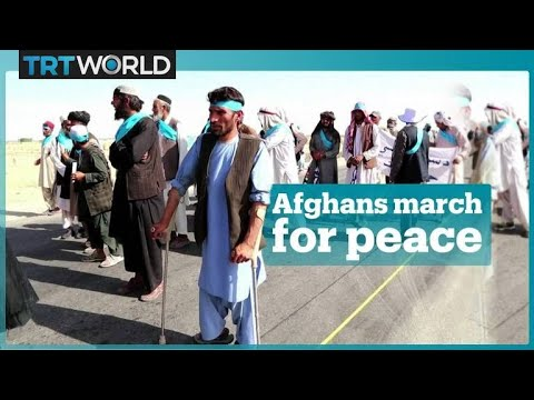 Afghans march hundreds of kilometres to demand peace