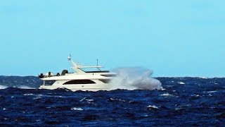 Luxury Yacht plunges deep into Rough Seas as Mighty River tosses it about