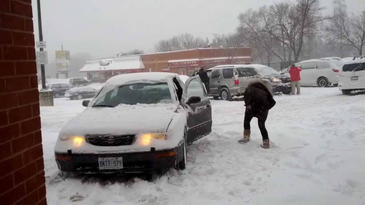 Car stuck in snow, it needs winter tires, sliding - YouTube