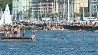 People cool off at Lake Geneva as temperatures soar in Switzerland   AFP
