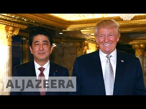 Japan's Abe arrives in US for Trump talks