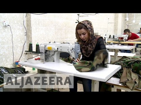Iraqi woman solving uniform shortage for Kurdish fighters