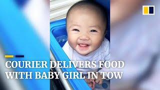 Download Delivery courier in China goes to work with baby girl in tow