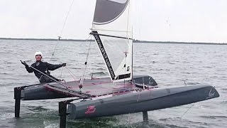 iFLY15 foiling catamaran flying stable on its  FlySafe® Automatic Hydrofoils