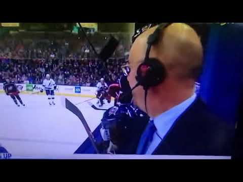 Maverick - Hockey announcer comes dangerously close to puck