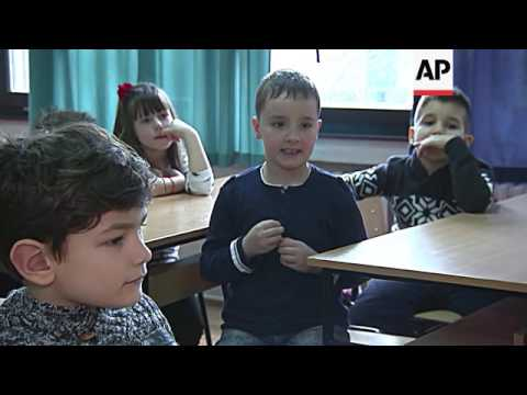 Bosnian first-graders reach out to deaf schoolmate