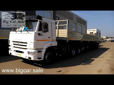 Автопоезд тягач КАМАЗ 65116-A5 и бортовой полуприцеп НЕФАЗ-9334-01