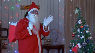 Old Santa in glass spectacles waving goodbye after celebrating Christmas in India