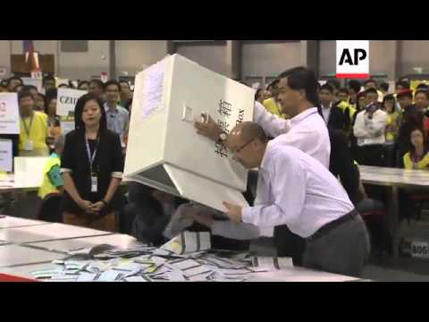 Chief Executive Leung Chun-ying watches vote counting
