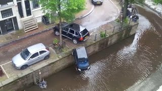 Stolen Porsche Cayenne pushes Smart into Canels of Amsterdam