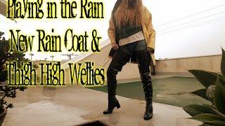 Playing in Rain in Thigh High Wellies & Yellow Rain Coat