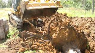 versatile earthmoving digging out the stump.AVI