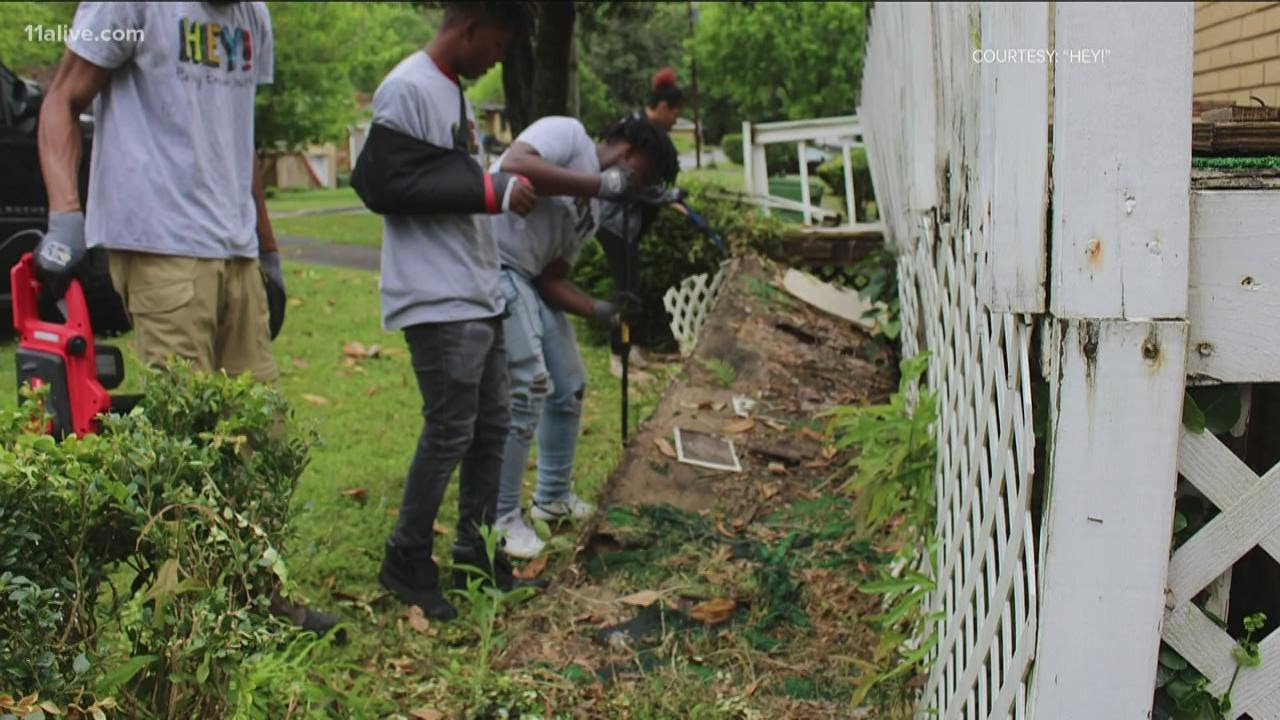 Helping Empower Youth's repairs Kathryn Johnston's  home