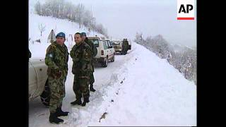 BOSNIA: SIPOVO: INHABITANTS LEAVE VILLAGE AS NATO TROOPS ARRIVE