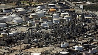 International Energy Agency report sees no quick end to oil glut