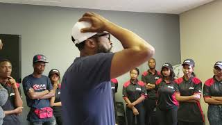 DJ Sbu speaking to Hustlers at The Hustlers Academy Johannesburg