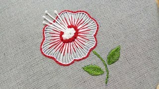 Hand embroidery of a flower with buttonhole stitch and french knots