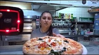 """Buying a freshly made Hand Stretched Pizza at one of our favourite Pizzeria's at """"ICCO"""", London."""