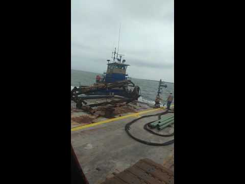 Demolition with a tugboat