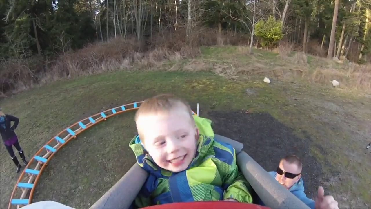 kid rides homemade backyard roller coaster for first time youtube