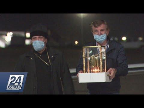 Благодатный огонь из Иерусалима доставили в Казахстан