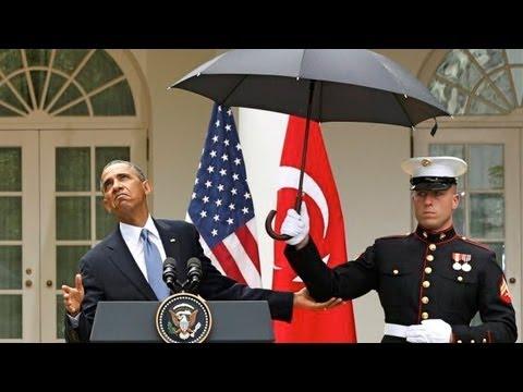 King Obama Calls Marines To Hold His Umbrella